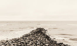 Rocks in the sea. Severel rocks helping to break the waves Royalty Free Stock Photos