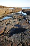Rocks on sea shore stock photos
