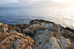 Rocks on sea shore Stock Photos