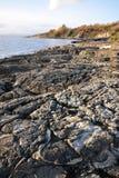 Rocks on sea shore royalty free stock photo