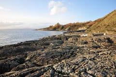 Rocks on sea shore stock photography
