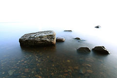 Rocks sea shore blue Stock Photography