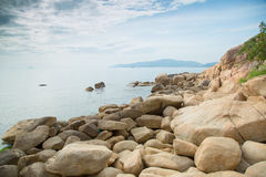 Rocks on the sea shore with clouds Royalty Free Stock Photos