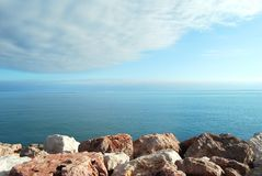 Rocks, sea and sky Stock Images