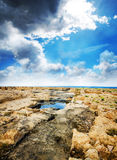 Rocks, sea and sky before storm Royalty Free Stock Image