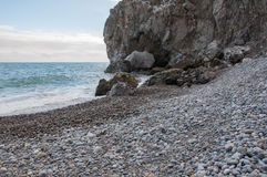 Rocks by the sea in a small storm. In high quality Stock Photo