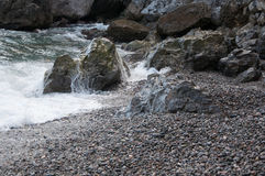 Rocks by the sea in a small storm. In high quality Royalty Free Stock Image