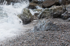 Rocks by the sea in a small storm. In high quality Royalty Free Stock Photo