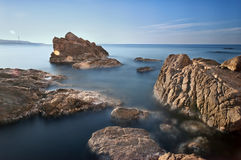 Rocks on the sea smooth. Rocks of Scylla (Reggio Calabria). I Used 2 ND filters Royalty Free Stock Image