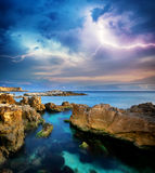 Rocks and sea storm. Dramatic scene. Composition of nature Stock Images