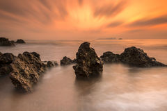 Rocks sea sunset Stock Image