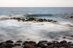 Rocks in the sea and surf Stock Image