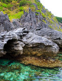 Rocks and sea. On a tropical island. Royalty Free Stock Image