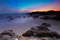 Seascape rocks beach on twillight Royalty Free Stock Photos