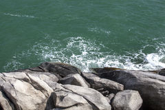Rocks and Sea. Sea waves breaking on rocks with splashes Stock Photography