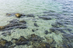 Rocks by the sea with waves of the Mediterranean sea next to the Royalty Free Stock Photo