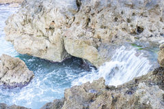 Rocks by the sea with waves of the Mediterranean sea next to the. Cabo de Formentor in the Balearic Islands, Spain. Scenes of Spanish tourism Royalty Free Stock Photos