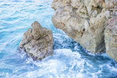 Rocks by the sea with waves of the Mediterranean sea next to the. Cabo de Formentor in the Balearic Islands, Spain. Scenes of Spanish tourism Royalty Free Stock Photography