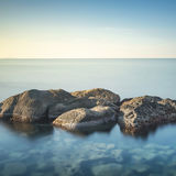 Rocks and sea in zen style. Long exposure photography Royalty Free Stock Photography