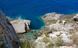 Rocks on the seacoast. Rocks breaks in the sea near Petrovac town, Montenegro Royalty Free Stock Image