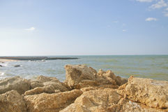 Rocks seaside. Rocks on the beach. Sunshine on the Stock Images