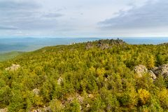 Rocks and Shad Tchup Ling Buddhist monastery on mountain Kachkanar. The Urals. Russia Stock Photos