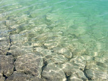 Rocks in shallow clear lake Royalty Free Stock Photography
