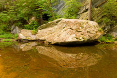 Rocks in a shallow river Stock Photo