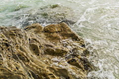 Rocks in shallow water. Shallow water with larger boulder rocks Stock Photo