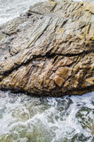 Rocks in shallow water. Shallow water with larger boulder rocks Stock Image