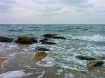 Rocks on shallow water Royalty Free Stock Photo