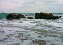 Rocks on shallow water. Two rocks on shallow water Stock Image