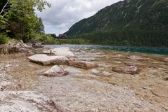 Rocks on the shore. Bank of a mountain lake in Poland Stock Photos