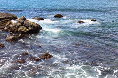 Rocks on the shore of the Indian ocean Stock Photography