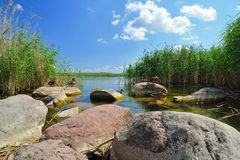 Rocks on the shore of the lake. Royalty Free Stock Image