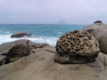 Rocks on shoreline. Strange rocks formed by water and waves' erosion, located on the shoreline of ocean pacific, taiwan Royalty Free Stock Photo