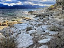 Rocks and shoreline, Corsica Royalty Free Stock Photos