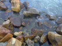 Rocks on the Shoreline. In Hout Bay, Western Cape, South Africa royalty free stock photos