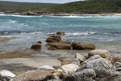 Rocks on shoreline at Marley beach in the Royal National Park. Sunny spring afternoon in the Royal National Park Bundeena, Australia royalty free stock photography