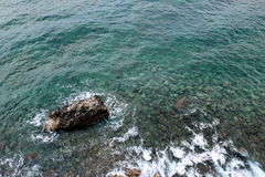 Rocks at the shoreline. Mediterranean sea at the rocky shoreline Royalty Free Stock Image