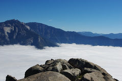Rocks and Sierra Nevada above clouds. Sequoia National Park, California Stock Photos
