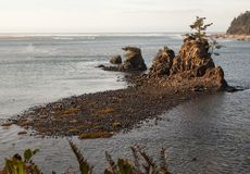 Tidal bay: Wildlife refuge. On Siletz Bay, a national wildlife refuge, these 3 small islands are exposed or covered depending on tidal flows providing a landmark Stock Photo