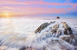 Rocks with silky water in Sopelana Stock Photo