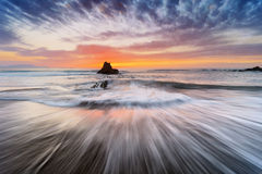 Rocks with silky water in Sopelana beach Stock Photography