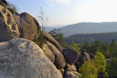 Rocks, sky, mountains an forest Royalty Free Stock Images