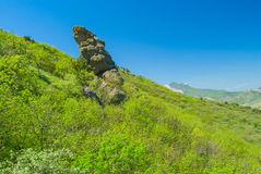 Rocks on slopes of ancient volcanic mountain range Kara Dag, Eastern Crimea. Disorderly lying rocks on slopes of ancient volcanic mountain range Kara Dag royalty free stock image