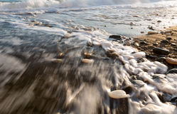 Rocks in soft milky sea water Royalty Free Stock Photos