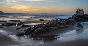 Rocks in Sopela beach in low tide. Basque Country Royalty Free Stock Images