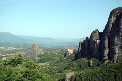 The rocks of St. Meteora in the central part of Greece. 06. 18. 2014. Landscape of mountainous nature, settlements and religious o. Panorama of the rocks of St Stock Photos