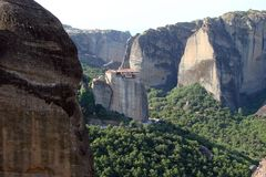 The rocks of St. Meteora in the central part of Greece. 06. 18. 2014. Landscape of mountainous nature, settlements and religious o. View of the Greek male Royalty Free Stock Image